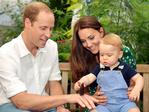 Catherine, Duchess of Cambridge holds Prince George as he and Prince William, Duke of Cambridge's look on while visiting the Sensational Butterflies exhibition at the Natural History Museum on July 2, 2014 in London, England. The family released the photo to mark the first birthday of Prince George on July 22. Picture: Getty