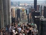 People view the solar eclipse at 'Top of the Rock' observatory at Rockefeller Center, August 21, 2017 in New York City. Picture: Drew Angerer/Getty Images/AFP