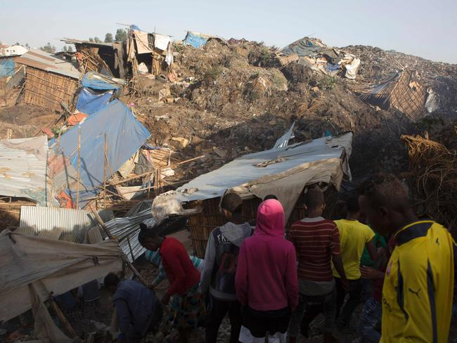 People look at the damage done to dwellings built near the main landfill of Addis Ababa. Picture: AP Photo/Elias Meseret