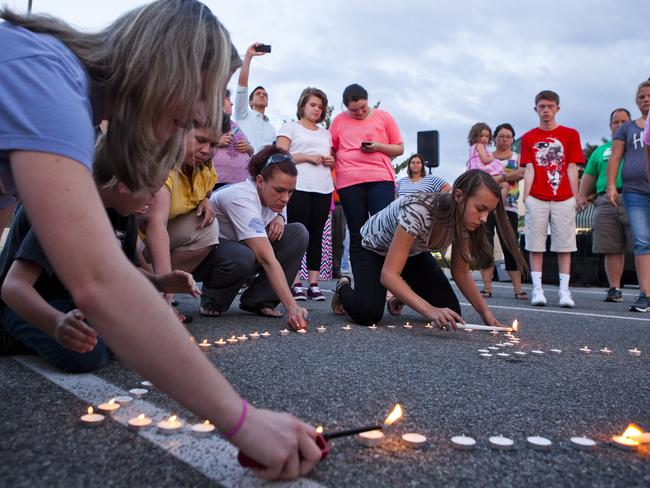 Memorial ... community members light a heart-shaped ring of candles during a prayer vigil organised by Vitalize Church in Hardy, Virginia. Picture: Griffin Moores/The Daily News Leader via AP