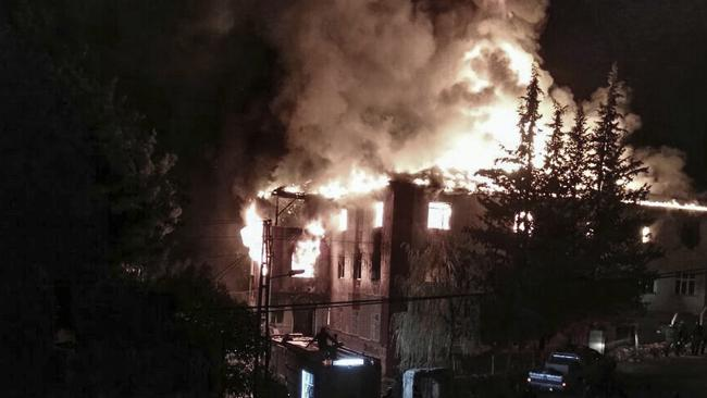 Flames tear through a school dormitory, in Aladag, Adana in southern Turkey killing 12 people. Picture: DHA via AP