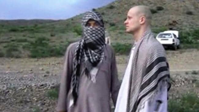 Waiting to leave ... Sgt. Bowe Bergdahl, right, stands with a Taliban fighter in eastern Afghanistan. Picture: Voice Of Jihad website via AP video