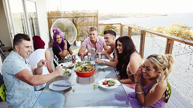 The Geordie crew eating dinner on the balcony of their palatial Coogee pad. Picture: MTV
