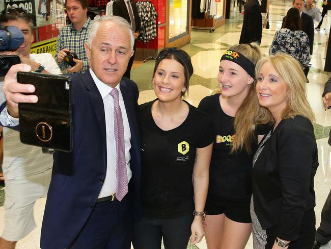 Prime Minister Malcolm Turnbull and NSW Liberal MP Karen McNamara pose for a photograph with young fans at Westfield shopping centre in Tuggerah today.