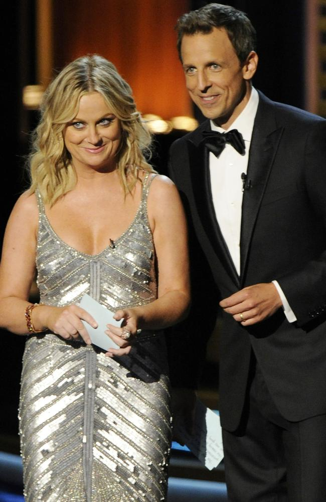 Amy Poehler, left, with this year's Emmys host, Seth Meyers.