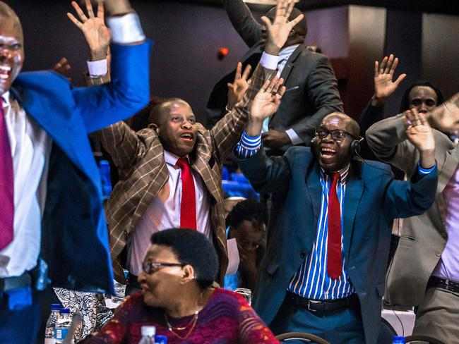 Zimbabwe's members of parliament celebrate after Mugabe's resignation. Picture: AFP