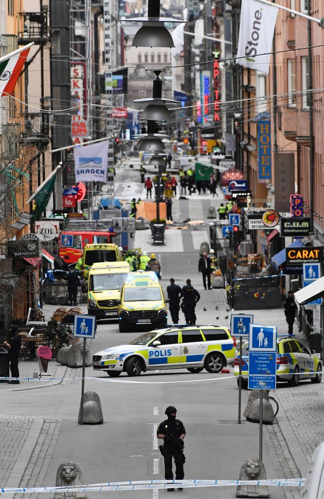 Emergency services and police work at the scene where a truck crashed into the Ahlens department store at Drottninggatan in central Stockholm. Picture: AFP.