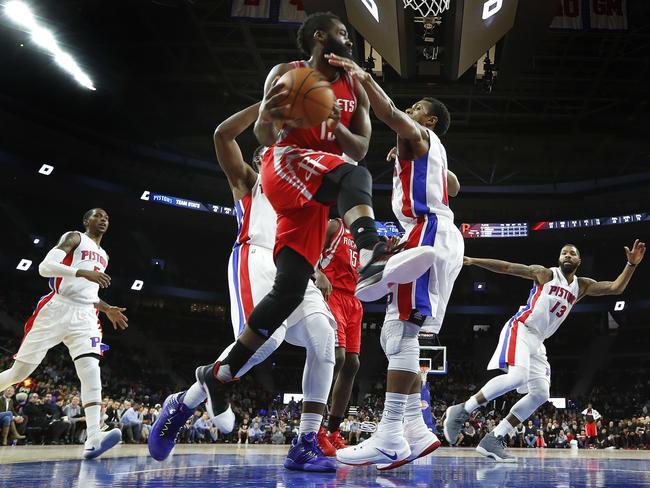 Houston Rockets guard James Harden (13) drives against the Detroit Pistons.