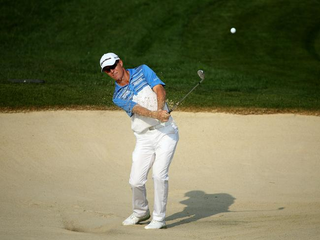 John Senden of Australia hits a shot from a bunker during a practice round at Valhalla Golf Club.