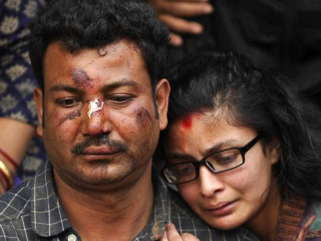 Heartbroken ... Nepalese residents mourn the death of a relative following an earthquake, at a mass cremation in Kathmandu. Picture: AFP/Prakash Mathema