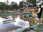 Flooding of the North Para River in the Barossa. Craig Wilson, who manages the Nuriootpa swimming pool, waits for flood water to subside. Picture: Dean Martin