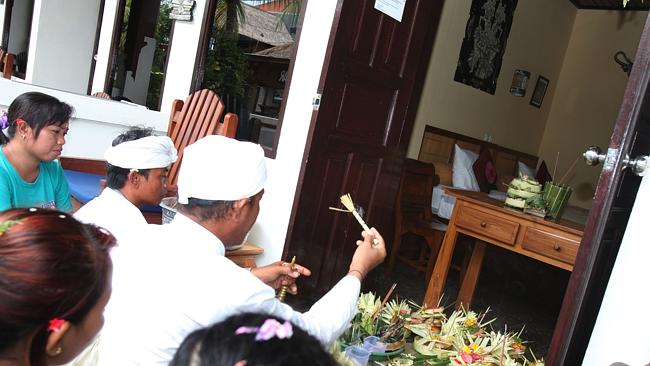 A Balinese priest and the staff of Padangbai Beach Resort take part in the cleansing ceremony.