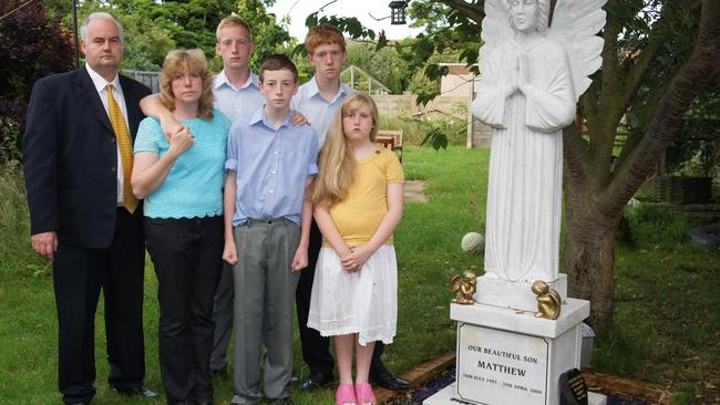 Tina and Chris Dear with their four children next to Matthew's grave.