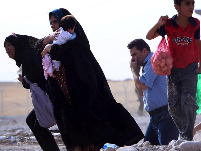 In the wake of disaster: Iraqi families flee violence in the northern Nineveh province. Picture: AFP