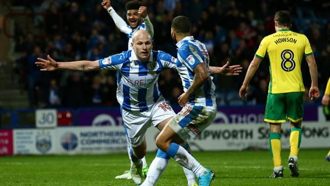Aaron Mooy celebrates scoring against Norwich.