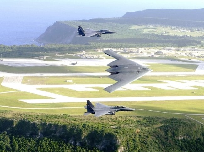 F-15E Strike Eagles and a B-2 Spirit bomber fly in formation over Andersen Air Force Base, in the north of the island. Picture: Cecilio Ricardo/US Air Force