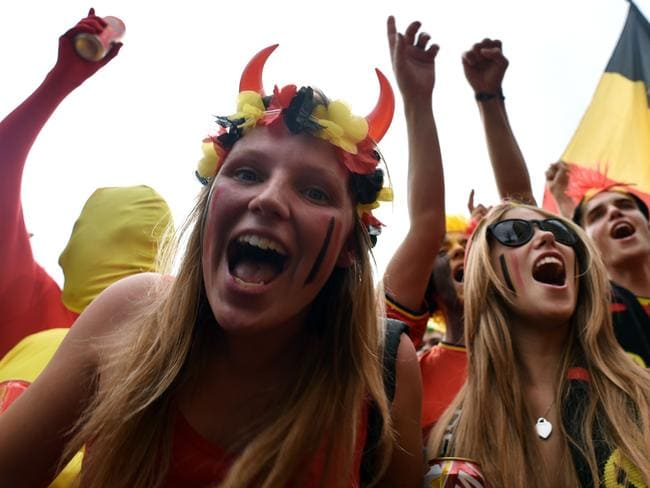 Belgium's fans cheer before the Group H football match between Belgium and Russia outside the Maracana Stadium.