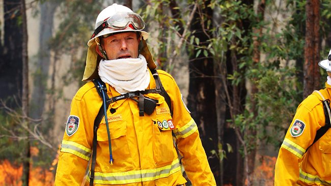 Helping hand ... Opposition Leader Tony Abbott working on containment lines in Conjola National Park / Pic: Craig Greenhill