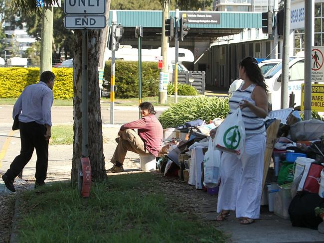 One of the 'Bondi Hoarder' Bobola sisters guarding their rubbish outside the Thrifty truck rentals on Bourke Rd Alexandria / Picture: Tim Hunter