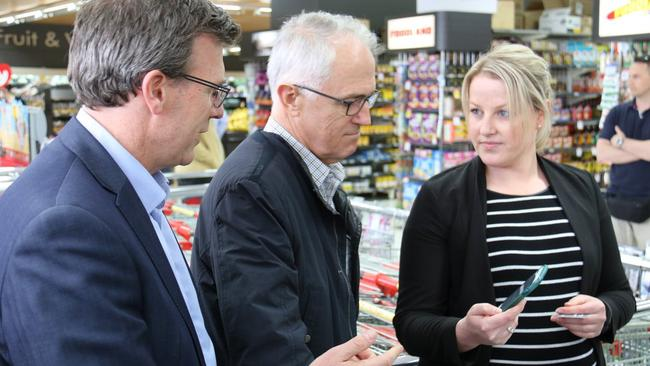 Malcolm Turnbull being shown the cashless welfare card at a Ceduna supermarket. Picture: Tom Fedorowytsch/Twitter