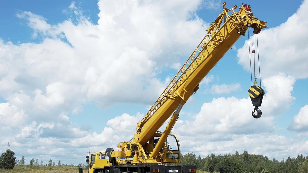 A school bus and a mobile crane have collided at Greenbank. Picture: File photo of a mobile crane