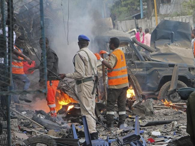 A Somali soldier inspects the wreckage of vehicles in Mogadishu. Picture: AP Photo/Farah Abdi Warsameh