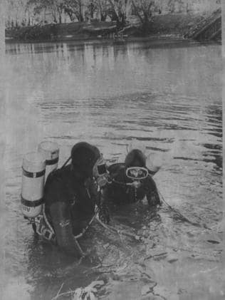Police divers search an area of water in the hope of finding the body of Donald Mackay.