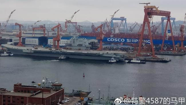 Tugboats are seen moving China's new, home-built, aircraft carrier - known as Type 001A (CV-17) - away from its dock in preparation for its first at-sea tests. Picture: Weibo