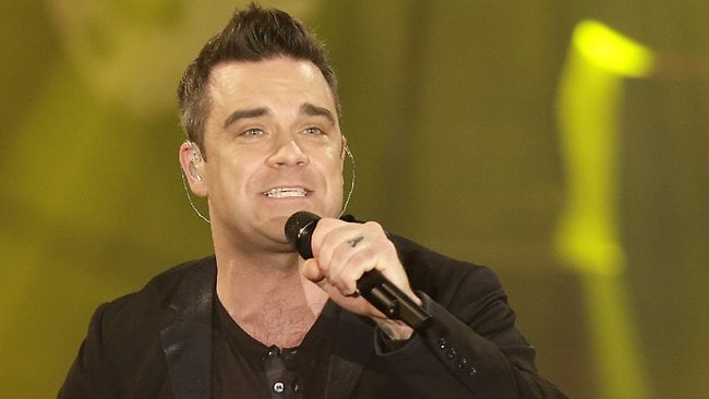 British pop star singer Robbie Williams has joined forces with Michael Buble.