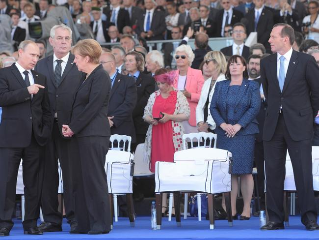 Distance: Prime Minister Abbott, far right, with world leaders including Mr Putin at this week's D-day commemorations in France. Picture: Jake Nowakowski