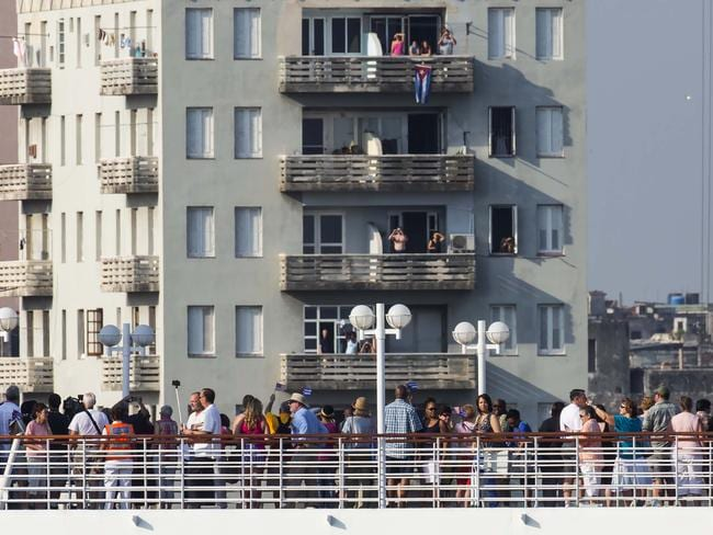 Passengers stand on the deck of Carnival's Adonia cruise ship as they arrive in Havana, Cuba. Picture: AP Photo/Ramon Espinosa