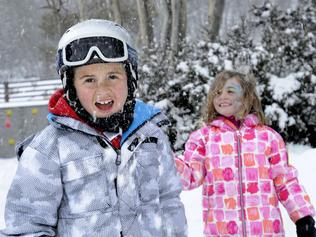 Lucie and Henry Sekzenian enjoy the winter wonders. Picture: Steve Cuff