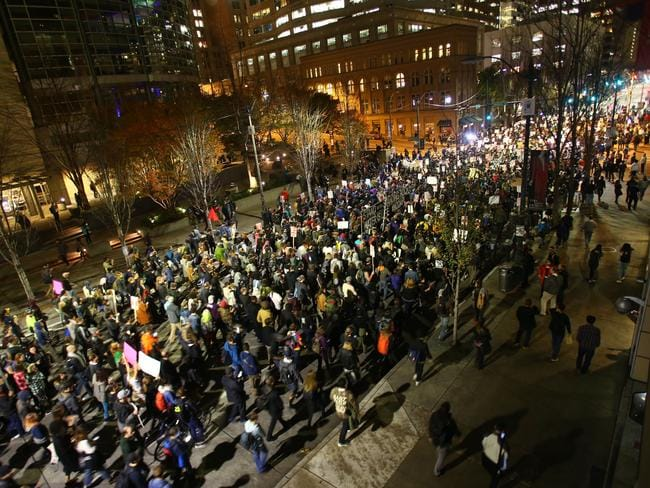 Thousands of protesters march down 2nd Avenue on November 9 in Seattle, Washington. Picture: Karen Ducey/Getty Images/AFP