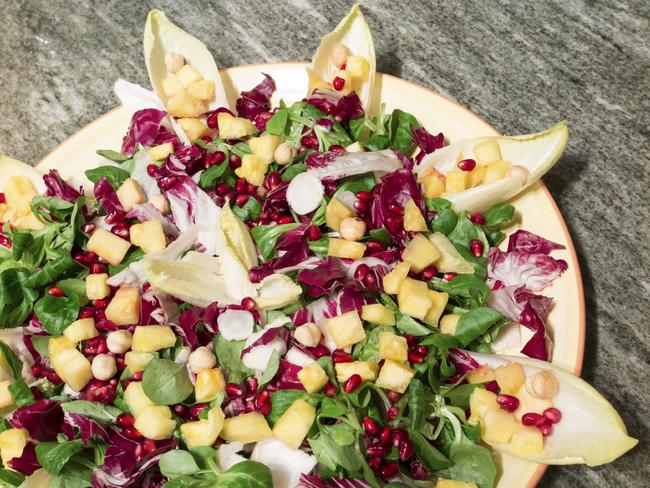Make salads interesting by using pomegranate seeds and different types of lettuce leaves.