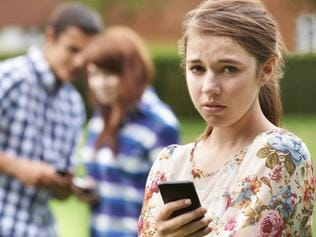 Bullying Teenage girl victim of bullying via text message.