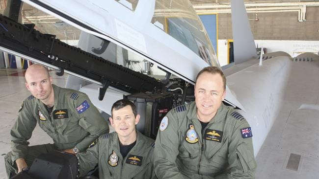 Taking control ... John Haly, Glen Braz and Steve Roberton in the cockpit of a Super Hornet at Lemoore US Navy airstation in California. Picture: Supplied