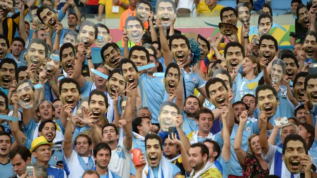 Uruguay's fans hold up cardboard cut outs of Uruguayan forward Luis Suarez.