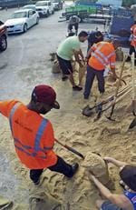 Residents fill up sandbags Thursday, Sept. 7, 2017, in Orlando, Fla., as they prepare for Hurricane Irma. Long lines of vehicles waited for hours to get a 10 sandbag limit at the City of Orlando Public Works. Picture: Red Huber/Orlando Sentinel via AP