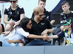 Prince Harry and Meghan Markle talk with a child while attending a Wheelchair Tennis match during the Invictus Games 2017 at Nathan Philips Square on September 25, 2017 in Toronto, Canada. Meghan can be seen here trying to shake the hand of Bailey Lawler (R), son of Sean Lawler who was competing. Picture: Getty Images