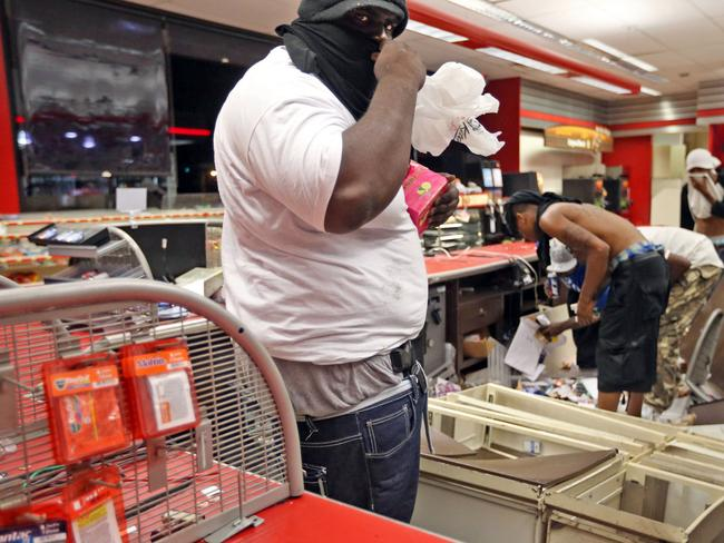 The vigil led to a night of rioting in the city. Picture: AP