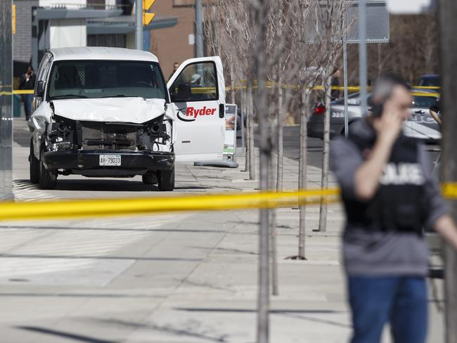 Police inspect a van suspected of being involved in the collision. Picture: Getty Images