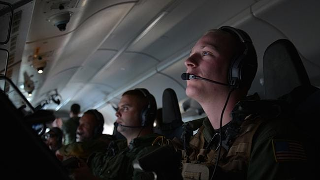 Sailors attached to Patrol Squadron (VP) 16 hard at work on board a P-8A Poseidon yesterday during the search for MH370. Picture: US Navy/Mass Communication Specialist 2nd Class Eric A. Pastor