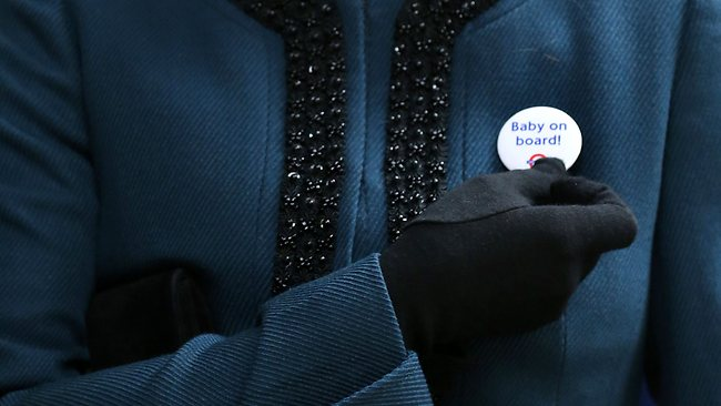 "Catherine, Duchess of Cambridge, wears a Transport For London badge that reads ""baby on board"", given to her during a visit to Baker Street tube station. Picture: Chris Radburn"
