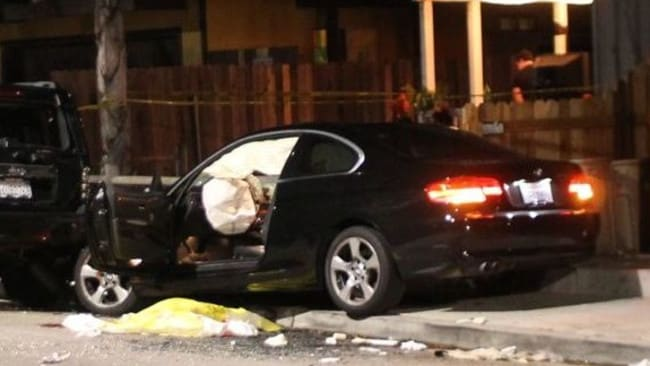 Wrecked car ... a BMW sedan sits wrecked on an Isla Vista sidewalk after the driver — who allegedly gunned down six people during a blocks-long shooting rampage Picture: Urban Hikers