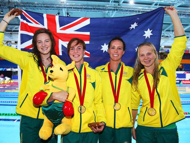 (L-R) Cate Campbell, Bronte Campbell, Emma McKeon and Melanie Schlanger of Australia celebrate their world record and gold medal.