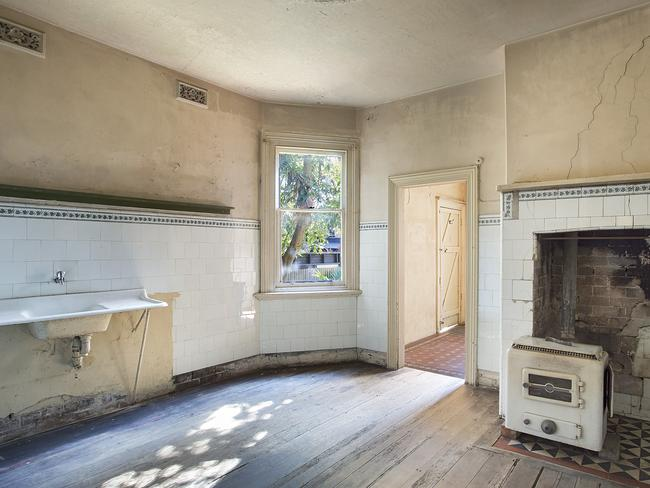The original kitchen is large and ripe for renovation.