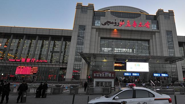 Scene ... Chinese police guard the entrance to the Urumqi South Railway Station after the deadly attack. Picture: AP