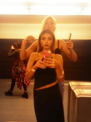 "Behind The Scenes 2014 MTV VMAs... Actress Sarah Hyland, ""Bathroom picture of @ImTheKatie combing my hair because she knows best."" Picture: Twitter"