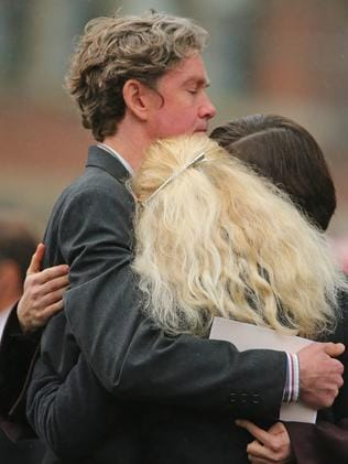 Mourners embrace as they leave St Patrick's Cathedral. Picture: Getty Images