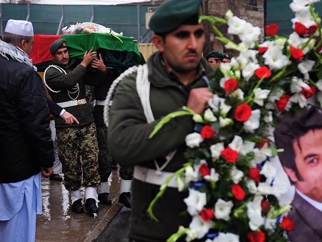 Mourned ... Afghan soldiers carry the casket of slain reporter Sardar Ahmad. Hundreds of well-wishers turned out to mourn the loss of Ahmad, his wife and two of their children who were killed in a Taliban attack. Picture: Roberto Schmidt